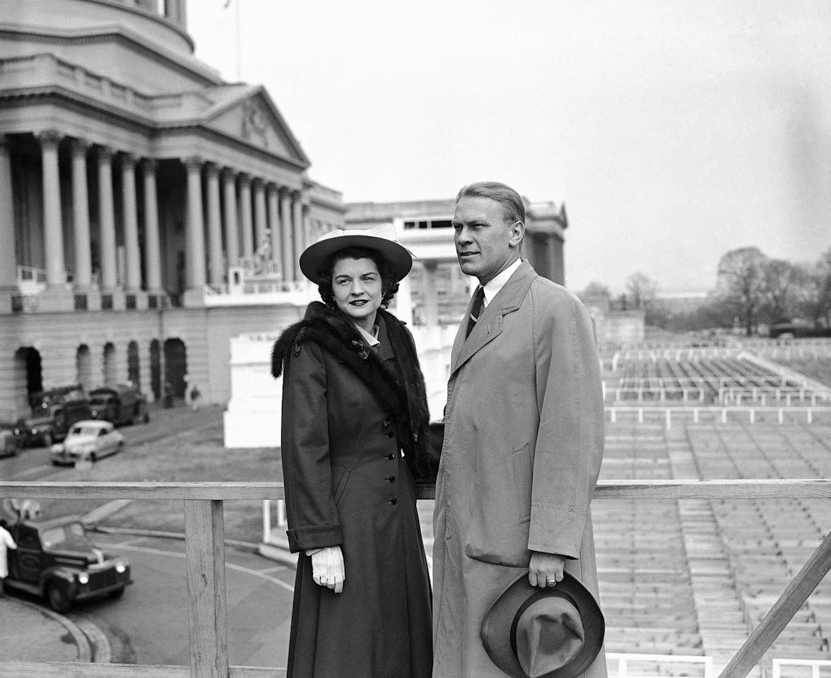 FILE - In this Jan. 4, 1949 file picture, Rep. Gerald R. Ford, Jr. of the Fifth Michigan District, and his wife Betty Ford stand on the inaugural stands in Lansing, Mich. On Friday, July 8, 2011, a family friend said that Betty Ford had died at the age of 93. (AP Photo)