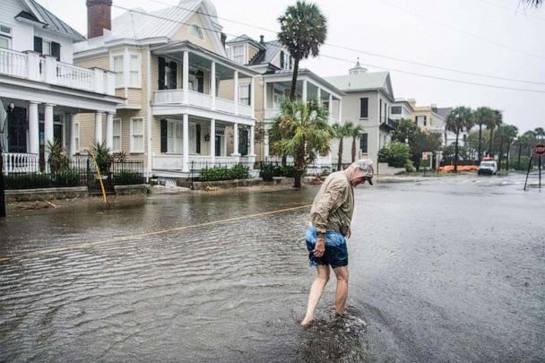PHOTO: Bill Olesner walks down South Battery Street while cleaning debris from storm drains on Sept. 5, 2019 in Charleston, S.C. as Hurricane Dorian brings wind and rain to the area. (Sean Rayford/Getty Images)