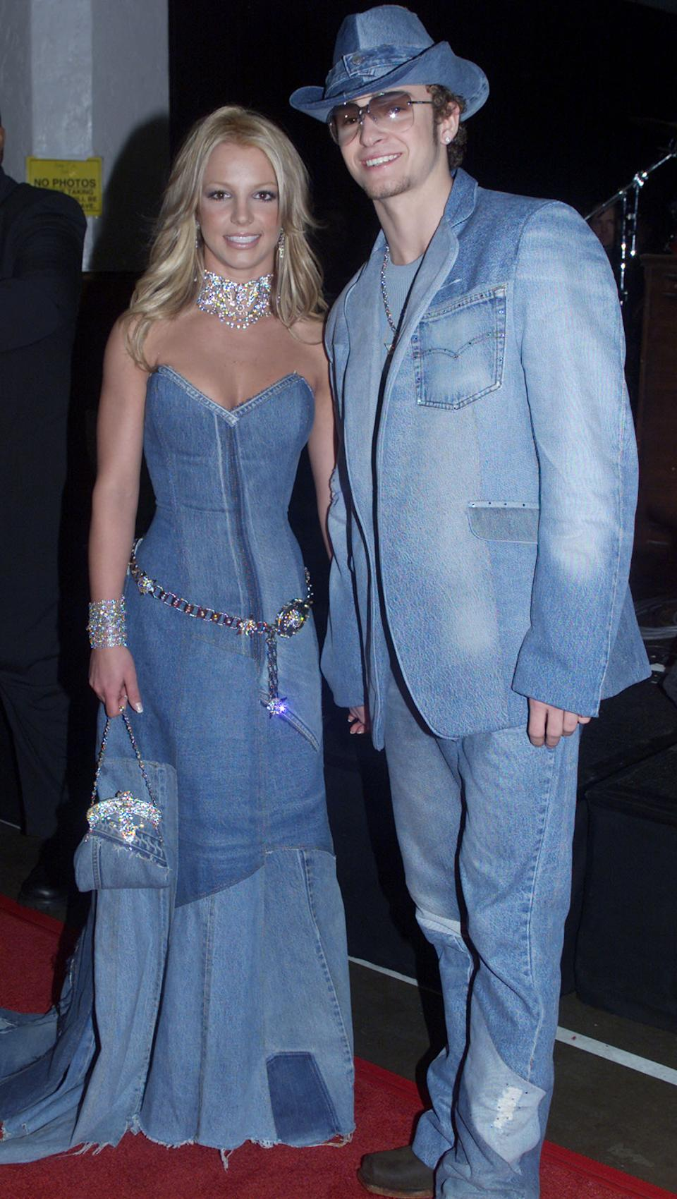 Singer Britney Spears and boyfriend Justin Timberlake of the group 'N Sync arrive at the 28th Annual American Music Awards January 8, 2001 at the Shrine Auditorium in Los Angeles. Spears is co-host of the awards show.