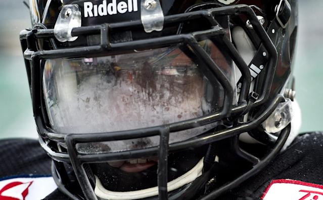 Hamilton Tiger-Cats defensive lineman Brandon Boudreaux peers through a frosted visor during practice in Regina, Saskatchewan, Wednesday Nov. 20, 2013. Hamilton and the Saskatchewan Roughriders will face off in the 101st Grey Cup on Sunday. (AP Photo/The Canadian Press, Paul Chiasson)