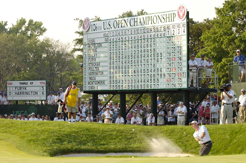 The leaderboard shows the scores as Jim Furyk of the United States hits out of a bunker on the 18th hole during the final round of the 2006 U.S. Open Championship at Winged Foot Golf Club. (Photo by Howard Earl Simmons/NY Daily News Archive via Getty Images)