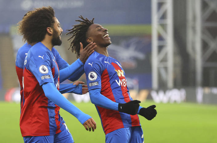 Crystal Palace's Eberechi Eze, right, celebrates after scoring his side's opening goal during the English Premier League soccer match between Crystal Palace and Wolverhampton Wanderers at Selhurst Park stadium in London, England, Saturday, Jan. 30, 2021. (Julian Finney/Pool via AP)