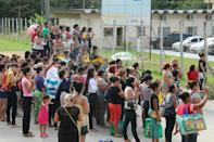 Relatives of inmates ask for information at the main gate of the Anisio Jobim Penitentiary Complex after a riot left 56 people killed in Manaus, Brazil on January 2, 2017 At least 60 people were killed in a prison riot in Brazil's Amazon region when fighting broke out between rival gangs