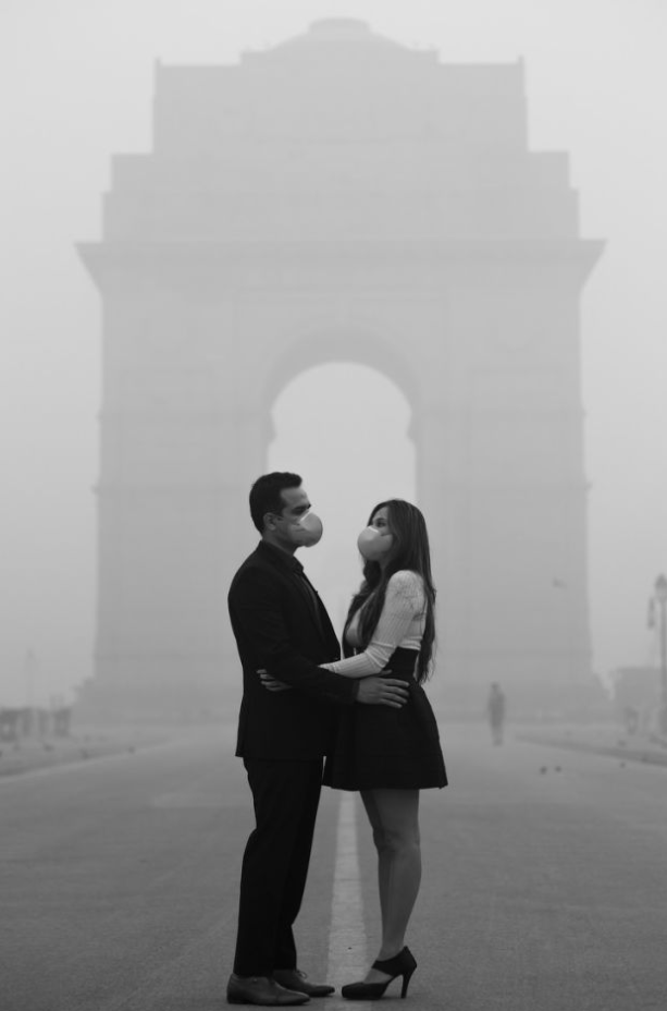 With their face masks on, the couple struggle to get close on their shoot. Photo: Banjara Studios