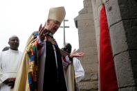 Archbishop of Canterbury Justin Welby prays outside the church after attending a special service at the Anglican Church of Kenya St. Stephen's Cathedral along Jogoo road in Nairobi