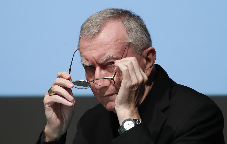 The Vatican secretary of state Cardinal Pietro Parolin adjusts his spectacles as he attends at the 150th anniversary of the arrival of Catholic missionaries in China from an Italian religious order meeting, in Milan, Italy, Saturday, Oct. 3, 2020. The Vatican doubled down Saturday on its intent to pursue continued dialogue with China over bishop nominations, defending the deal as necessary to the life of the Catholic Church there over strong U.S. objections. (AP Photo/Antonio Calanni)