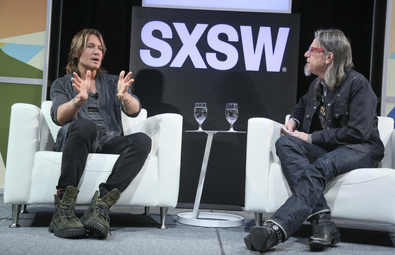 """Keith Urban, left, and Scott Goldman of the Grammy Museum talk during the """"Creation and Connection: A Conversation with Keith Urban"""" featured session during the South by Southwest Music Festival and Conference at the Austin Convention Center on Friday, March 16, 2018, in Austin, Texas. (Photo by Jack Plunkett/Invision/AP)"""