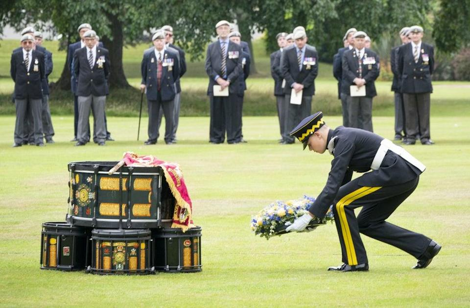 A wreath of remembrance is laid by Trooper Bell (Jane Barlow/PA) (PA Wire)