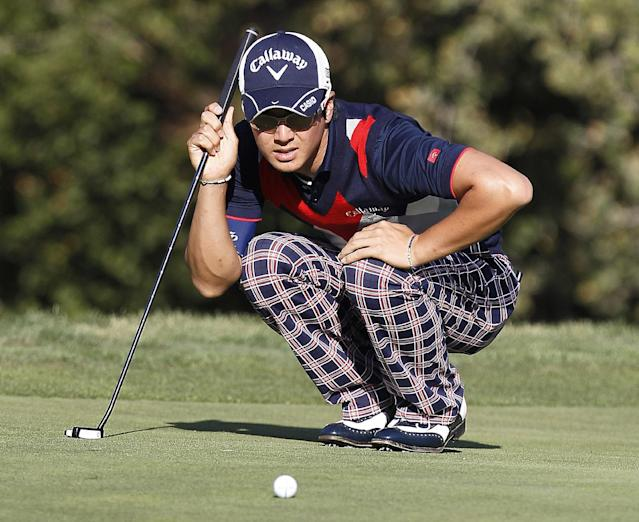 Ryo Ishikawa, of Japan, lines up a putt on the 18th hole during the third round of the Frys.com Open golf tournament, Saturday, Oct. 12, 2013, in San Martin, Calif. (AP Photo/Tony Avelar)