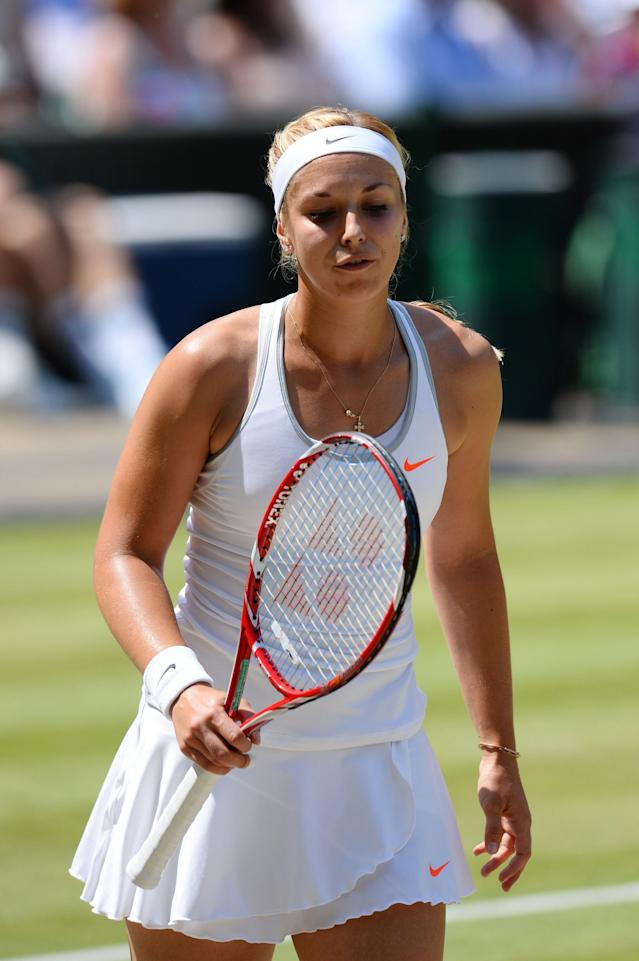 LONDON, ENGLAND - JULY 06: Sabine Lisicki of Germany reacts during the Ladies' Singles final match against Marion Bartoli of France on day twelve of the Wimbledon Lawn Tennis Championships at the All England Lawn Tennis and Croquet Club on July 6, 2013 in London, England. (Photo by Mike Hewitt/Getty Images)