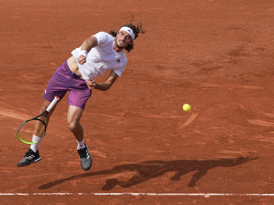 Stefanos Tsitsipas of Greece loses grip of his racket as he serves to Spain's Pedro Martinez during their second round match on day four of the French Open tennis tournament at Roland Garros in Paris, France, Wednesday, June 2, 2021. (AP Photo/Michel Euler)