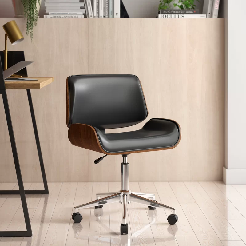 """<h2>AllModern Mack Task Chair</h2><br><strong>Best For: Style & Comfort </strong><br>This super sleek and Scandi-vibe task chair combines a sturdy chrome base with a curved wood back and seat with comfy glossy black LeatherSoft upholstery for your WFH behind — oh, and, according to reviewers, it looks even better in person and is also very easy to put together.<br><br><strong>The Hype:</strong> 4.7 out of 5 stars and 699 reviews on <a href=""""https://www.allmodern.com/furniture/pdp/cabrera-task-chair-a001173930.html"""" rel=""""nofollow noopener"""" target=""""_blank"""" data-ylk=""""slk:AllModern"""" class=""""link rapid-noclick-resp"""">AllModern</a><br><br><strong>Comfy Butts Say: </strong>""""This chair has style and comfort dialed in. It seems well made and I can sit for hours and hours at a time without pain.""""<br><br><br><br><strong>AllModern</strong> Mack Task Chair, $, available at <a href=""""https://go.skimresources.com/?id=30283X879131&url=https%3A%2F%2Fwww.allmodern.com%2Ffurniture%2Fpdp%2Fmack-task-chair-a000916462.html"""" rel=""""nofollow noopener"""" target=""""_blank"""" data-ylk=""""slk:AllModern"""" class=""""link rapid-noclick-resp"""">AllModern</a>"""