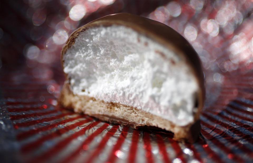 """A Tunnock's Tea Cake is seen in Edinburgh, Scotland May 2, 2014. Started in 1890, Tunnock's is one of the oldest family firms in Scotland, their teacakes contain a puff marshmallow atop a biscuit covered in a layer of milk or dark chocolate. Scottish separatists are closing the gap on their unionist rivals as a September independence referendum draws nearer, according to a poll. But pollster TNS said it would still be a """"major task"""" for them to draw level in time. In a poll of 995 adults, TNS found that support for the pro-independence campaign had grown by two points to 32 percent compared with last month, while the campaign to reject independence had slipped back a point to 41 percent. In the run-up to the vote, Reuters photographer Suzanne Plunkett took a series of close-up pictures of food, drink and various objects typically associated with Scotland. Picture taken May 2, 2014. REUTERS/Suzanne Plunkett  (BRITAIN - Tags: POLITICS FOOD SOCIETY)    ATTENTION EDITORS: PICTURE 06 OF 28 FOR PACKAGE 'DETAILS OF SCOTLAND'  TO FIND ALL IMAGES SEARCH 'PLUNKETT DETAIL'"""