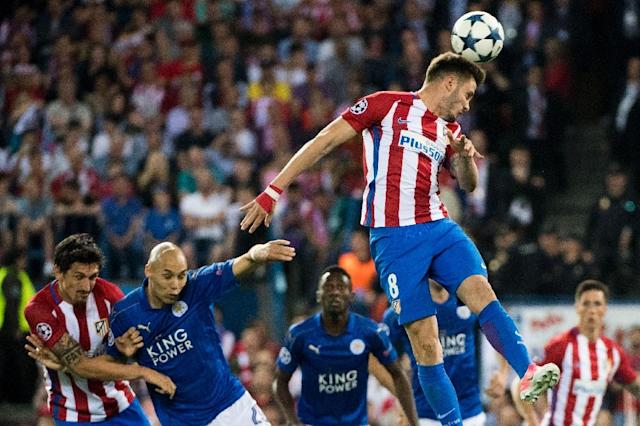 Atletico Madrid's midfielder Saul Niguez goes up for a header during the UEFA Champions League quarter final first leg football match against Leicester City April 12, 2017 (AFP Photo/CURTO DE LA TORRE)