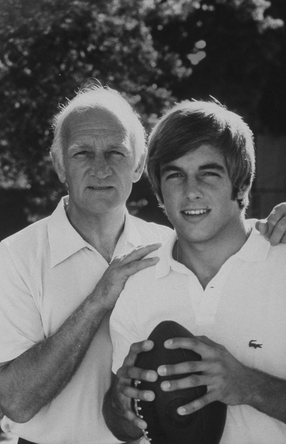 """<p>Mark Harmon poses next to his father (University of Michigan football star Tom Harmon) in the early '70s, when the actor was <a href=""""https://footballfoundation.org/hof_scholars.aspx?hof=779"""" rel=""""nofollow noopener"""" target=""""_blank"""" data-ylk=""""slk:quarterback at the University of California at Los Angeles"""" class=""""link rapid-noclick-resp"""">quarterback at the University of California at Los Angeles</a>. Mark turned down offers to play in the NFL and instead pursued a career in acting, which seems to be going well for him.</p>"""