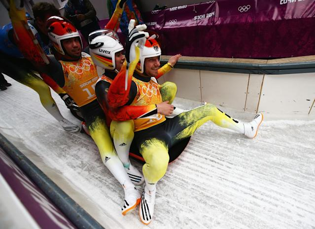 SOCHI, RUSSIA - FEBRUARY 13: (L-R) Tobias Wendl, Natalie Geisenberger and Tobias Arlt of Germany react after a run during the Luge Relay on Day 6 of the Sochi 2014 Winter Olympics at Sliding Center Sanki on February 13, 2014 in Sochi, Russia. (Photo by Doug Pensinger/Getty Images)