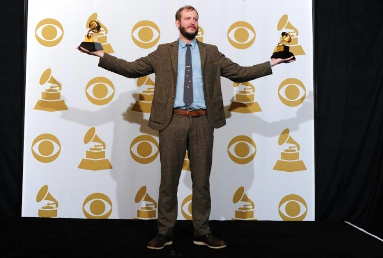 Justin Vernon of Bon Iver poses with the Best Alternative Music Album and the Best New Artist award at the 2012 gala