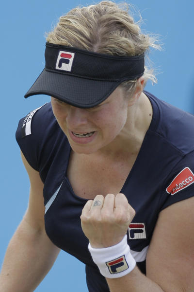 Kim Clijsters of Belgium clenches her fist aftre scoring a point in her match against Francesca Schiavone of Italy at the Unicef Open grass court tennis tournament in Rosmalen, central Netherlands, Thursday, June 21, 2012. Clijsters won in two sets 6-3, 7-6. (AP Photo/Peter Dejong)