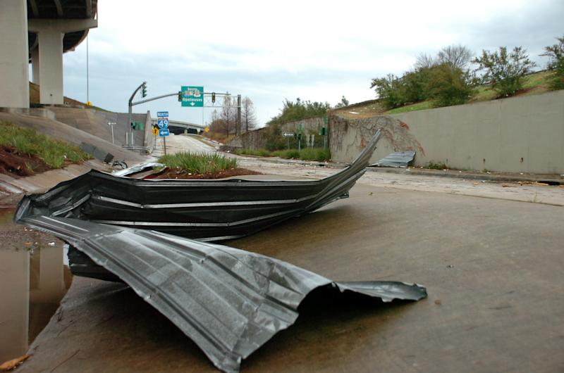 Debris sits on the frontage road near I-49 in downtown Alexandria, La., after an apparent tornado tore through the area Tuesday, Dec. 25, 2012. (AP Photo/The Daily Town Talk, Melinda Martinez) NO SALES