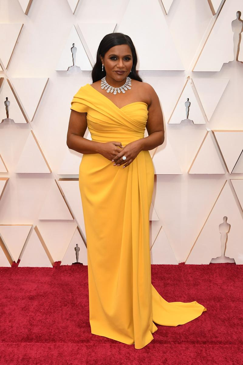 """Clearly <a href=""""https://www.huffingtonpost.ca/entry/jessica-mulroney-mindy-kaling-oscars-2020_ca_5e4093a2c5b6b70887022a4e?ptj"""" target=""""_blank"""" rel=""""noopener noreferrer"""">Jessica Mulroney is good at her job</a>, because this Dolce &amp; Gabbana dress is incredible. The canary-yellow colour, the gathered bodice, and asymmetrical shoulders are so simple but so glam."""