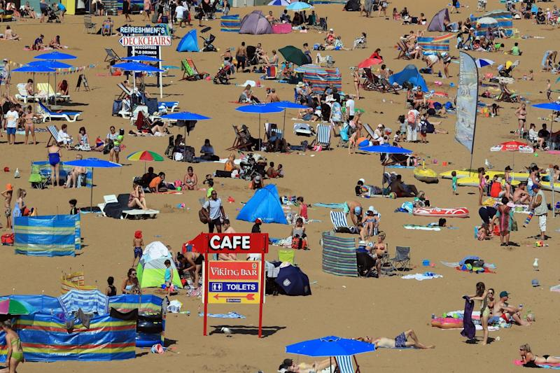 People enjoy the sunny weather on the beach in Broadstairs, Kent: PA