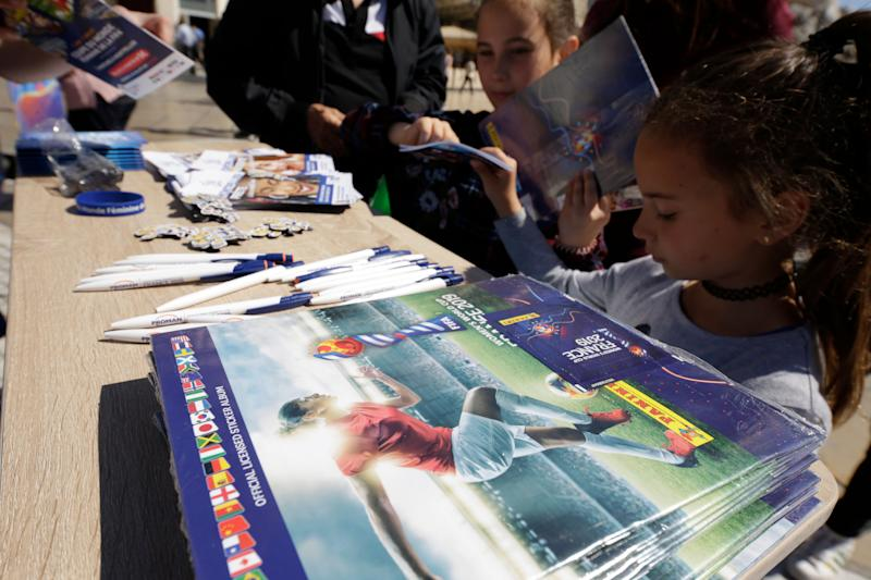 MONTPELLIER, FRANCE - MAY 22: Leaflets, Panini collection booklets and other FIFA merchandising products are distributed at Place de la Comedie during the FIFA Women's World Cup France 2019 National Trophy Tour on May 22, 2019 in Montpellier, France. (Photo by Johannes Simon - FIFA/FIFA via Getty Images )
