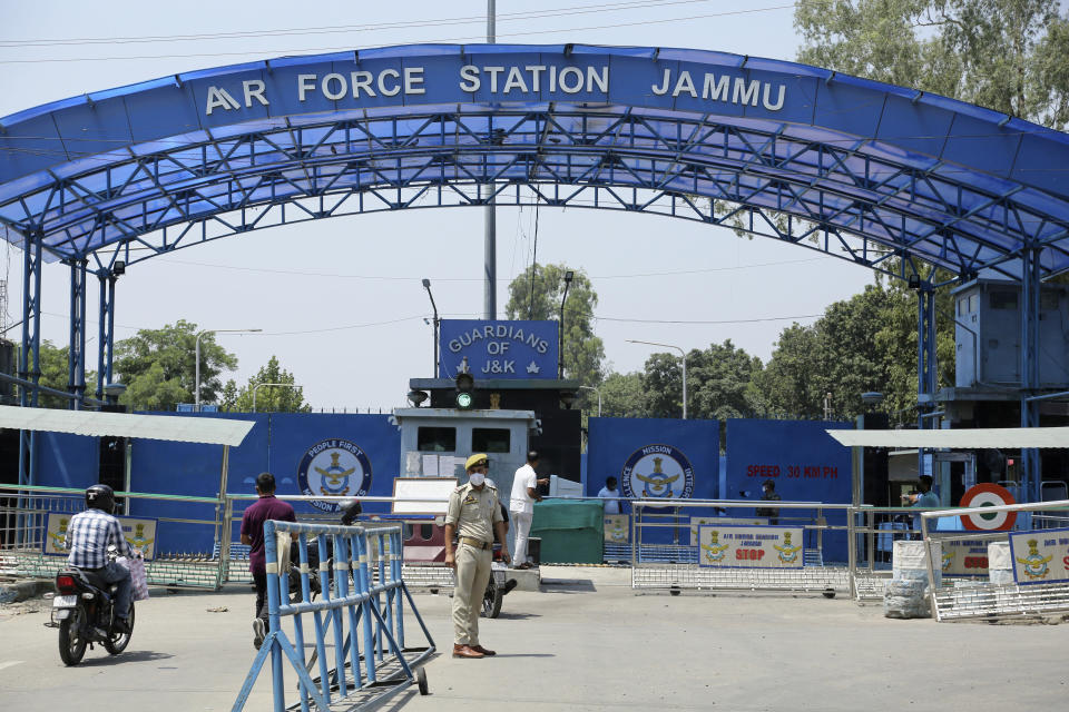 A police officer stands outside the Jammu air force station after two suspected blasts were reported early morning in Jammu, India, Sunday, June 27, 2021. Indian officials said Sunday they suspected explosives-laden drones were used to attack the air base in the disputed region of Kashmir, calling it the first such incident of its kind in India. (AP Photo/Channi Anand)