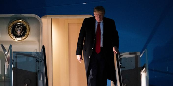 President Donald Trump exits Air Force One on Wednesday, Jan. 22, 2020, at Andrews Air Force Base, Md., after returning from the World Economic Forum in Davos, Switzerland. (AP Photo/Kevin Wolf)