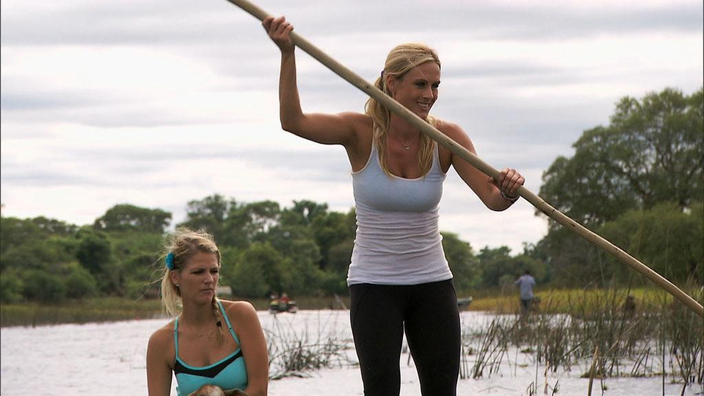 """""""Be Safe and Don't Hit a Cow"""" -- In this Road Block, Country singers Jennifer (left) and Caroline (right) must propel a Mokoro, a traditional canoe, down the Thamalakane River to a near by village where they will exchange two goats for the next clue, on """"The Amazing Race."""""""