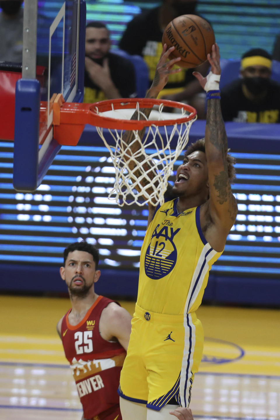 Golden State Warriors' Kelly Oubre Jr, right, shoots against Denver Nuggets' Austin Rivers during the first half of an NBA basketball game in San Francisco, Friday, April 23, 2021. (AP Photo/Jed Jacobsohn)