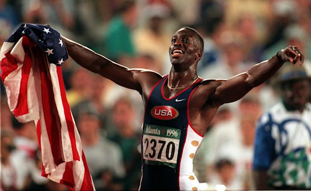 Michael Johnson of the United States celebrates after winning gold in the men's 200 meters in a new world record time of 19.32 at the 1996 Summer Olympic Games in Atlanta, Thursday August 1, 1996. (AP Photo/Denis Paquin)