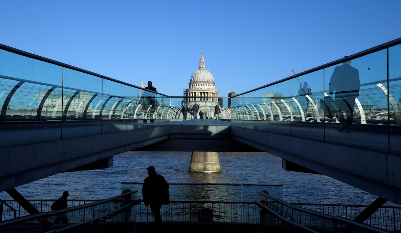St Paul's Cathedral dominates the city skyline as people walk across the Millennium Bridge, London, Britain, December 14, 2017. REUTERS/Toby Melville     TPX IMAGES OF THE DAY