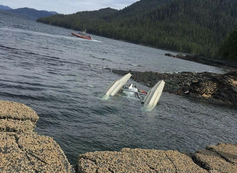 A sunken seaplane was seen at the site of the crash with part of the craft visible from above the water. Source: United States Coast Guard