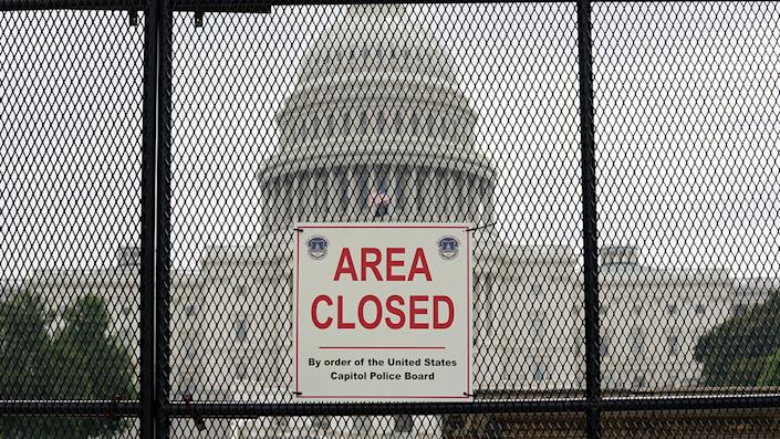 The U.S. Capitol is seen behind fencing that was erected in the wake of the January 6 insurrection, which is expected to be taken down as early as tomorrow in Washington, U.S., July 8, 2021. (Kevin Lamarque/File Photo/Reuters)