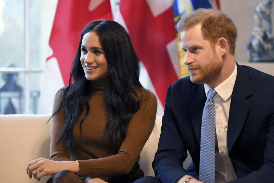 FILE - In this Tuesday, Jan. 7, 2020 file photo, Britain's Prince Harry and Meghan, Duchess of Sussex smile during their visit to Canada House, in London. Prince Harry and his wife Meghan 'stepping back' as senior UK royals, will work to become financially independent, they announced Wednesday, Jan. 8, 2020.(Daniel Leal-Olivas/Pool Photo via AP, file)