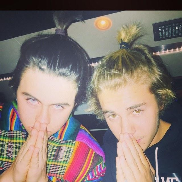 "Posing with Nash Grier, Bieber later captioned this image simply ""#Ponytails."""