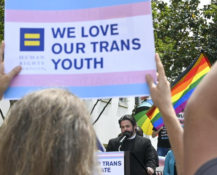"""<span class=""""caption"""">A rally at the Alabama Statehouse on March 30, 2021, to draw attention to and protest anti-transgender legislation introduced in Alabama.</span> <span class=""""attribution""""><a class=""""link rapid-noclick-resp"""" href=""""https://www.gettyimages.com/detail/news-photo/the-rev-david-chatel-speaks-during-a-rally-at-the-alabama-news-photo/1232024622?adppopup=true"""" rel=""""nofollow noopener"""" target=""""_blank"""" data-ylk=""""slk:Julie Bennett/Getty Images"""">Julie Bennett/Getty Images</a></span>"""