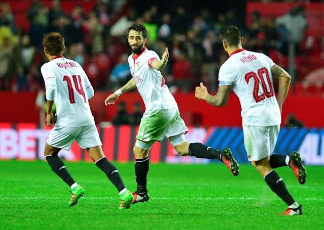 Sevilla's Argentinian defender Nicolas Pareja (C) celebrates a goal during the Spanish league football match against Valencia CF November 26, 2016