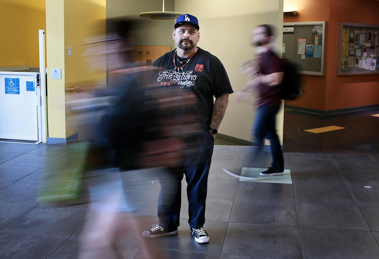Martin Leyva, a formerly incarcerated student, stands outside class where he is a teacher's assistant at California State University San Marcos. (Photo: Sandy Huffaker for Yahoo News)