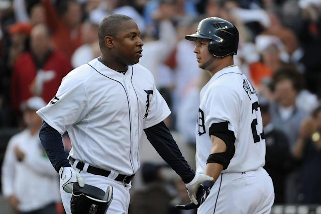 DETROIT, MI - OCTOBER 13: Delmon Young #21 of the Detroit Tigers celebrates with Jhonny Peralta #27 after hitting a solo home run in the fourth inning of Game Five of the American League Championship Series against the Texas Rangers at Comerica Park on October 13, 2011 in Detroit, Michigan. (Photo by Harry How/Getty Images)