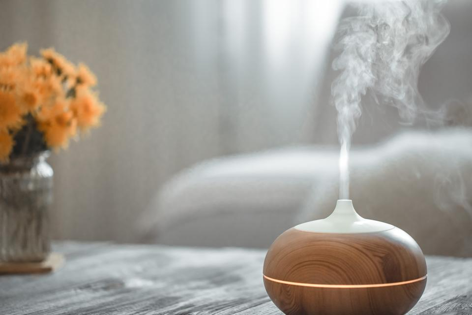 Humidifier on the table in the living room. Ultrasonic technology, increase the humidity in the room, comfortable living conditions.