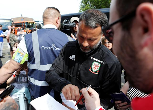 Soccer Football - Wales Training - The Racecourse, Wrexham, Britain - May 21, 2018 Wales manager Ryan Giggs signs an autograph for a fan before training Action Images via Reuters/Craig Brough