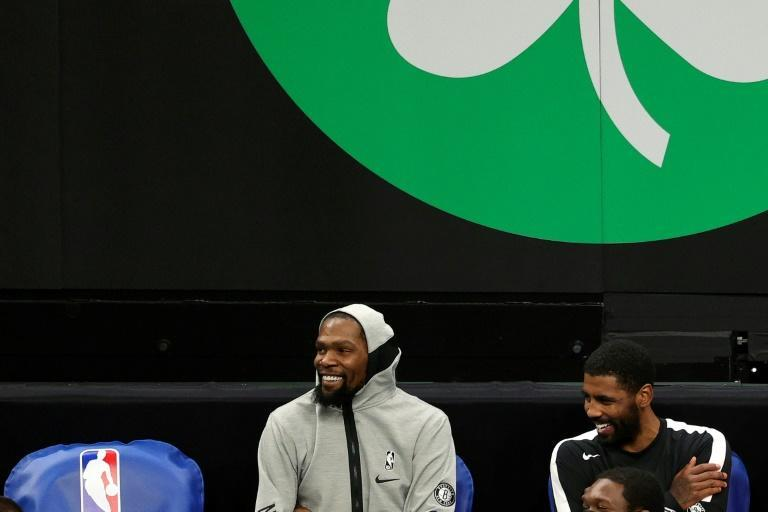 Brooklyn Nets teammates Kevin Durant and Kyrie Irving during an NBA pre-season game against the Boston Celtics