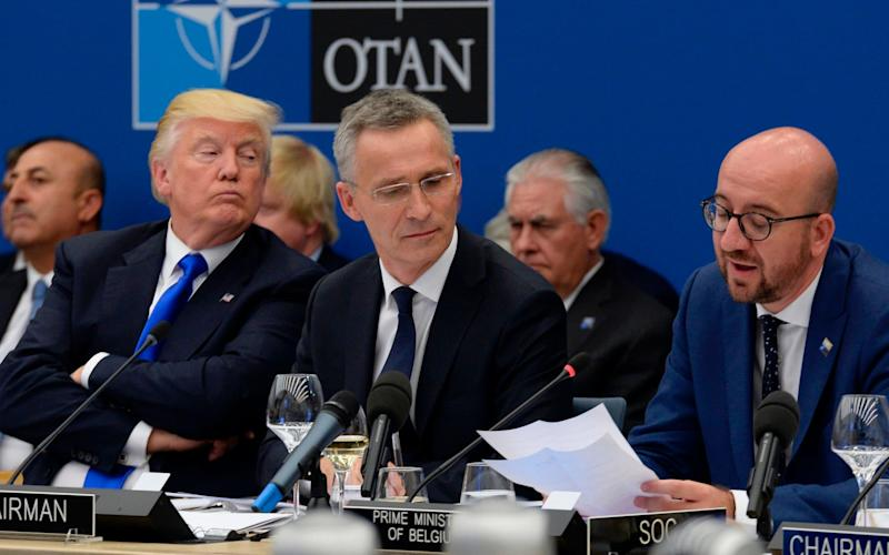 Donald Trump (L) and Jens Stoltenburg (Centre) at a Nato summit in 2017 - AFP