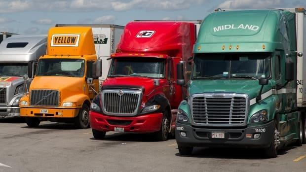 Twenty two truckers tested positive for COVID-19 between early December and April 12, and in turn directly infected 30 people. Eighteen rotational workers tested positive for COVID-19 in the same period and directly infected four people. (David Donnelly/CBC - image credit)