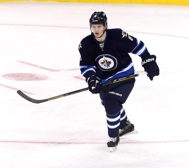 WINNIPEG, MB - OCTOBER 4: Jacob Trouba #8 of the Winnipeg Jets skates down the ice during first period action in an NHL home opener game against the Los Angeles Kings at the MTS Centre on October 4, 2013 in Winnipeg, Manitoba, Canada. (Photo by Marianne Helm/Getty Images)