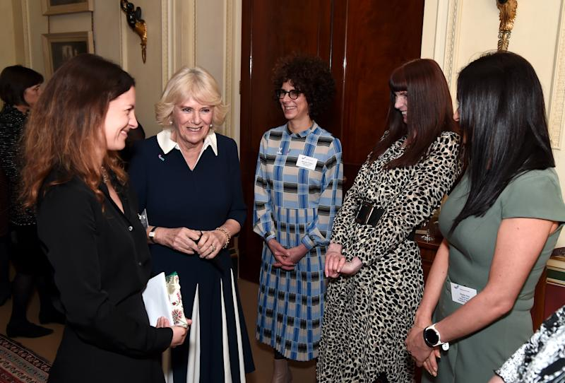 LONDON, ENGLAND - FEBRUARY 12: Camilla, Duchess of Cornwall talks to CEO of SafeLives Suzanne Jacob (L), SafeLives staffers Michelle Phillips, Melani Morgan and Susie Hay during a reception to acknowledge the 15th anniversary of domestic abuse charity SafeLives at Clarence House on February 12, 2020 in London, England. (Photo by Eamonn M. McCormack/Getty Images)