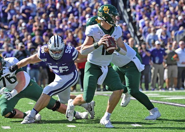MANHATTAN, KS - OCTOBER 05: Quarterback Charlie Brewer #12 of the Baylor Bears drops back to pass against defensive end Wyatt Hubert #56 of the Kansas State Wildcats during the first half at Bill Snyder Family Football Stadium on October 5, 2019 in Manhattan, Kansas. (Photo by Peter G. Aiken/Getty Images)