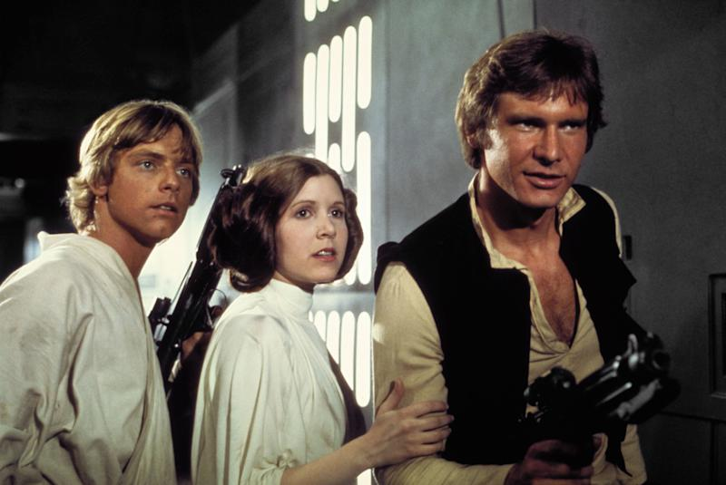 <strong>Mark Hamill, Carrie and Harrison as Luke Skywalker, Princess Leia and Han Solo in 'A New Hope' </strong> (Lucasfilm/Fox/Kobal/REX/Shutterstock)