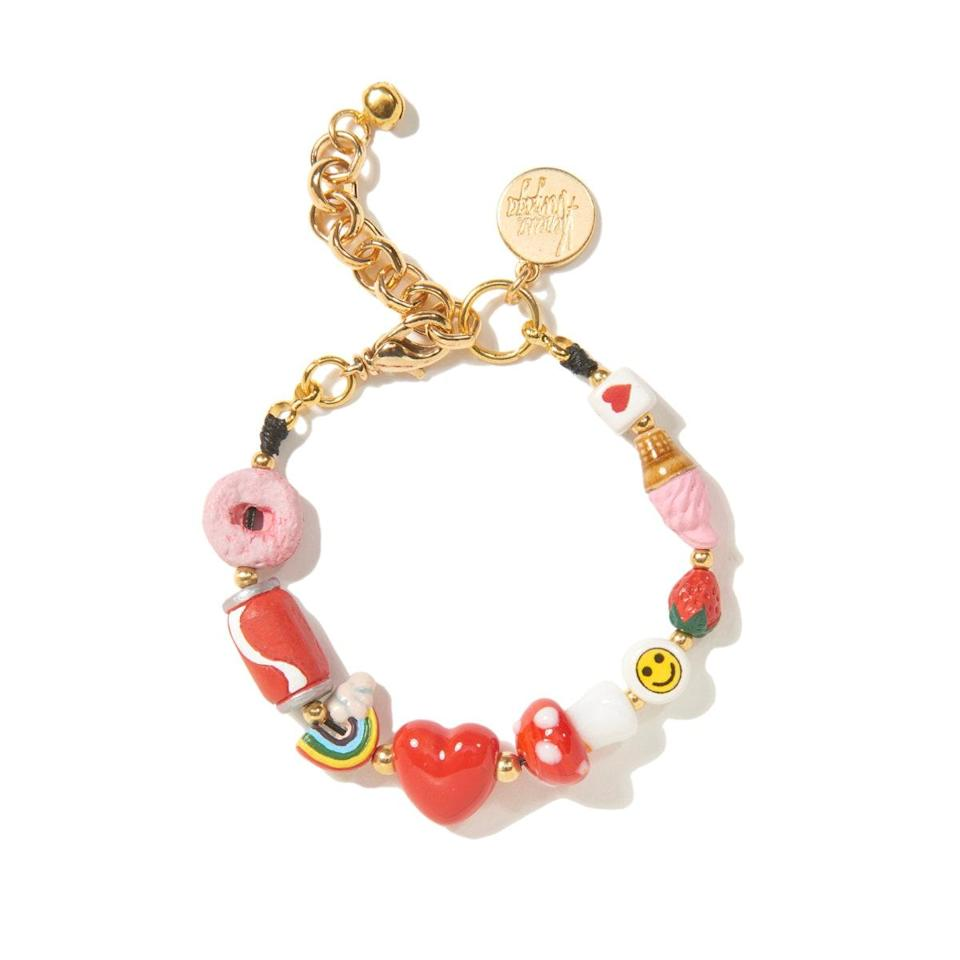 """Froot Loops! Rainbows! Strawberries! She'll be planning 100 outfits around this <a href=""""https://www.glamour.com/story/summer-camp-jewelry-trend?mbid=synd_yahoo_rss"""" rel=""""nofollow noopener"""" target=""""_blank"""" data-ylk=""""slk:campy bracelet-slash-anklet"""" class=""""link rapid-noclick-resp"""">campy bracelet-slash-anklet</a>, thoughtfully made by hand by New York-based jewelry designer Venessa Arizaga. $95, Urban Outfitters. <a href=""""https://www.urbanoutfitters.com/shop/venessa-arizaga-sweet-spot-charm-bracelet"""" rel=""""nofollow noopener"""" target=""""_blank"""" data-ylk=""""slk:Get it now!"""" class=""""link rapid-noclick-resp"""">Get it now!</a>"""